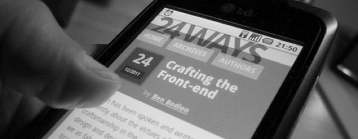 Grayscale photo of the 24 Ways website on smartphone.